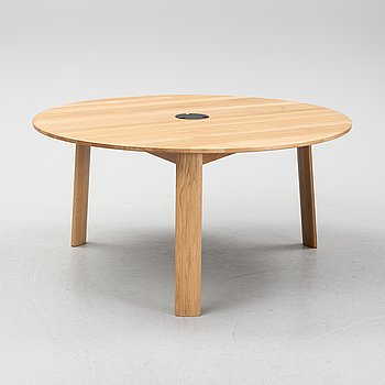 A round oak 'Alle Round Media Table' by Staffan Holm, Hem Design Studio. 21st Century.