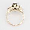 Cabochon demantoid garnet and old-cut diamond ring.