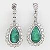 Emerald platinum an diamond drop earrings.