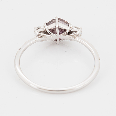 White gold, hexagonal shaped fancy purple pink diamond and brilliant-cut diamond ring.