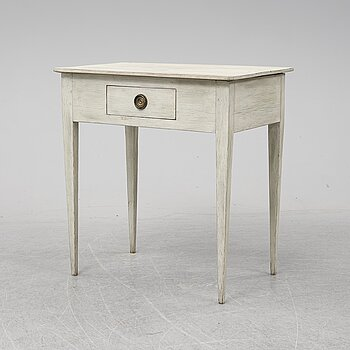 An early 19th Century painted table with a drawer.