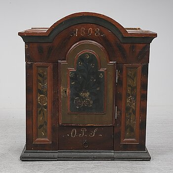 A painted pine wall cabinet, dated 1808.
