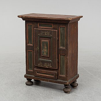 A painted cabinet, marked 1814.