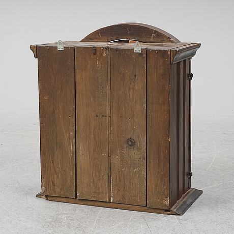 A painted pine wall cabinet, 19th century.
