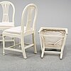 Four early 20th century painted gustavian style chairs.