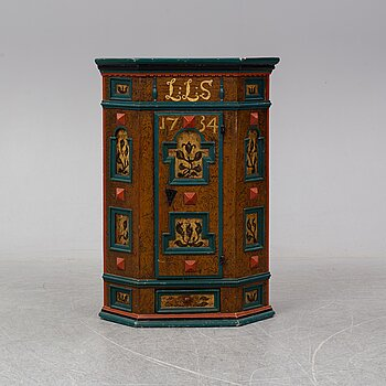 An 18th century painted cabinet.