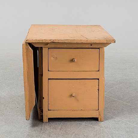 A 19th century childs gate legged table.