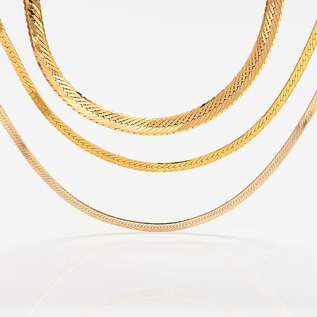 Two 14k gold bracelets and a 9k gold neckalce.