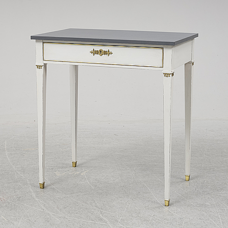 A gustavian style table, first half of the 20th century.