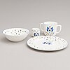 Cartier, a four piece porcelain child's 'la maison des enfants' dinner set.