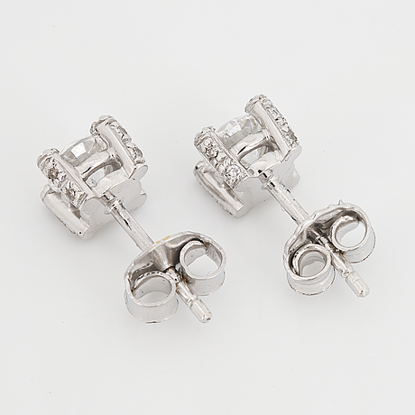 Brilliant-cut diamond stud earrings.