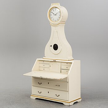 A 19th century painted cabinet with clock.