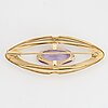18k gold and amethyst brooch.