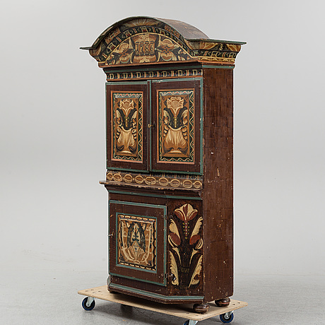 A painted cabinet marked 1787.