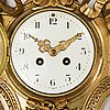 A first half of the 20th century brass wall clock.