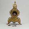 A rococo-style mantle-clock from the first half of the 20th century.