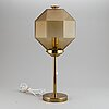A decond half of the 20th century brass and glass table light from bergboms.