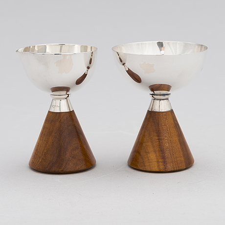 Anna-greta eker, a set of a silver and mahogany sugar bowl and cream jug, auran kultaseppä, turku 1962.
