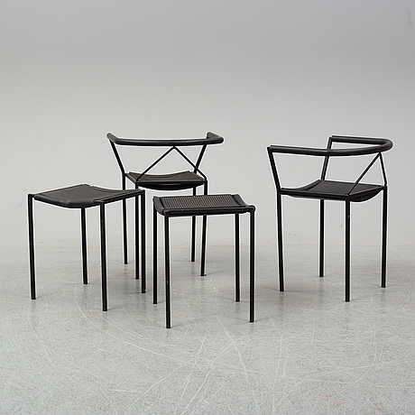 A set of four 21st century chairs.
