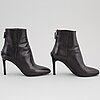 Prada, a pair of black leather boots, size 35.