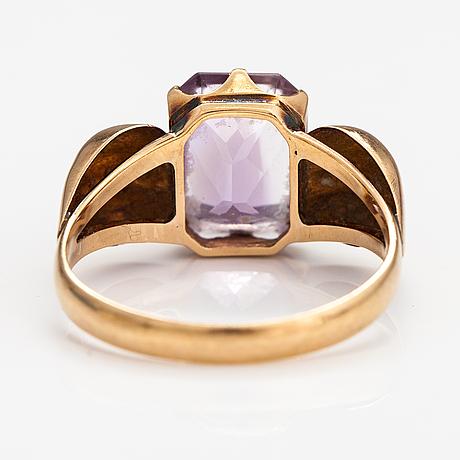 A 14k gold ring with an amethyst. rikhard n. sund, helsinki 1953.
