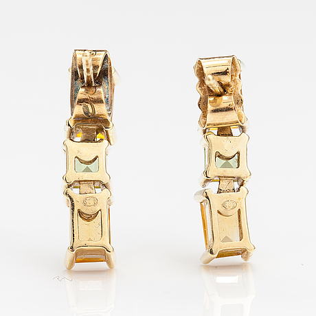 A pair of 14k gold earrings with citrines and peridotes.