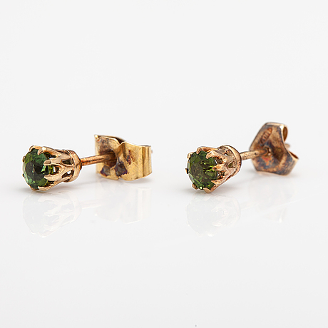 A pair of 14k gold earrings with tourmalines.