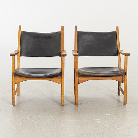 A pair of 'caryngo' arm chairs by carl malmsten and yngve ekström for ese-furniture, vaggeryd, sweden 1955.