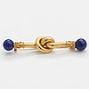 An 18k gold brooch, needle 14k gold, with lapiz lazuli.