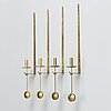 """Four brass """"pendel"""" wall candle holders by pierre forssell for skultuna 1978, sweden."""