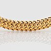 """An 18k gold tiffany necklace """"vannerie""""."""