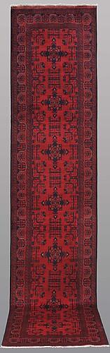 """A runner, afghan s.k """" khan mohammadi """", ca 384 x 80 cm."""