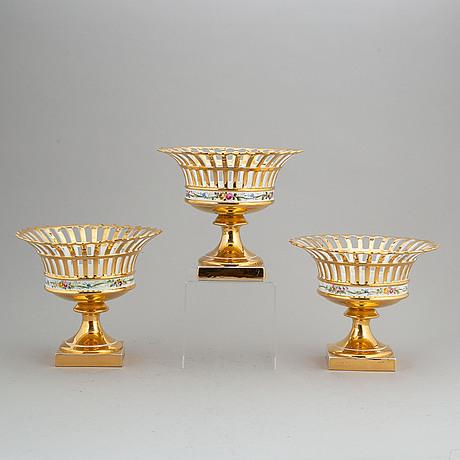 Three rörstrand porcelain footed chestnut baskets, circa 1900.