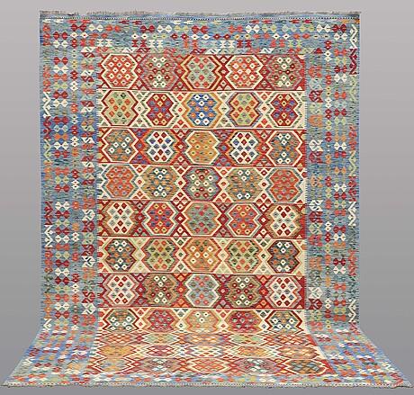 A carpet, kilim, ca 353 x 247 cm.