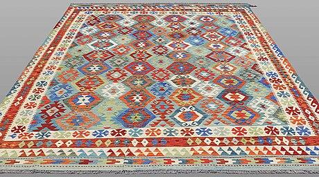 A carpet, kilim, ca 293 x 248 cm.