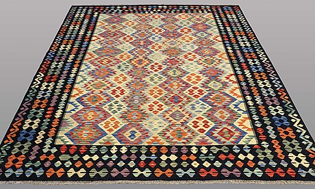 A carpet, kilim, ca 295 x 212 cm.