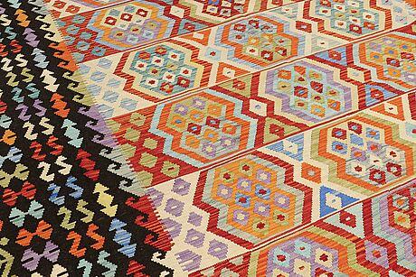 A carpet, kilim, ca 375 x 285 cm.