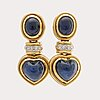 Earrings 18k gold w cabochon-cut sapphires and brilliant-cut diamonds.