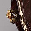 ChloÉ, a brown leather bag.