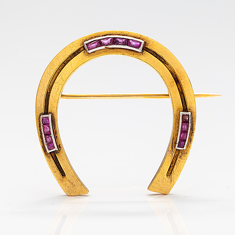 A 14k gold brooch with rubies. france.