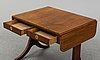 A first half of the 19th century mahogany veneered table.