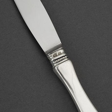 Eric löfman, 12 silver 'uppsala' knives, mark of kg markströms guldsmeds ab, stockholm 1968.