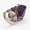 A silver ring with an amethyst.