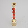 Sigurd persson, a brass and coral candlestick, uno berg ab.