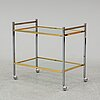 A metal and glass drinks trolley, 1970's/80's.