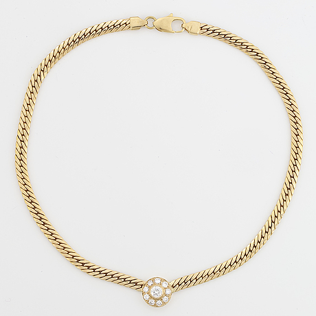 18k gold and brilliant-cut diamond necklace.