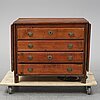 A 19th century chest of drawers with a table top.