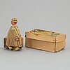 A tinplate fritz voith man with suitcase, germany, 1950s.