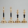 Skultuna messingsbruk,  two pairs mpair of brass and wood candlestick, around 1900.