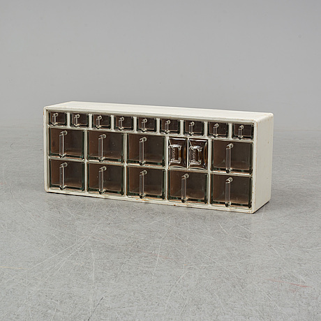 A glass and wood spice rack, mid 20th century.